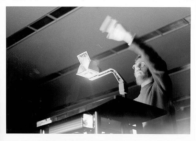 blurred teacher overhead projector