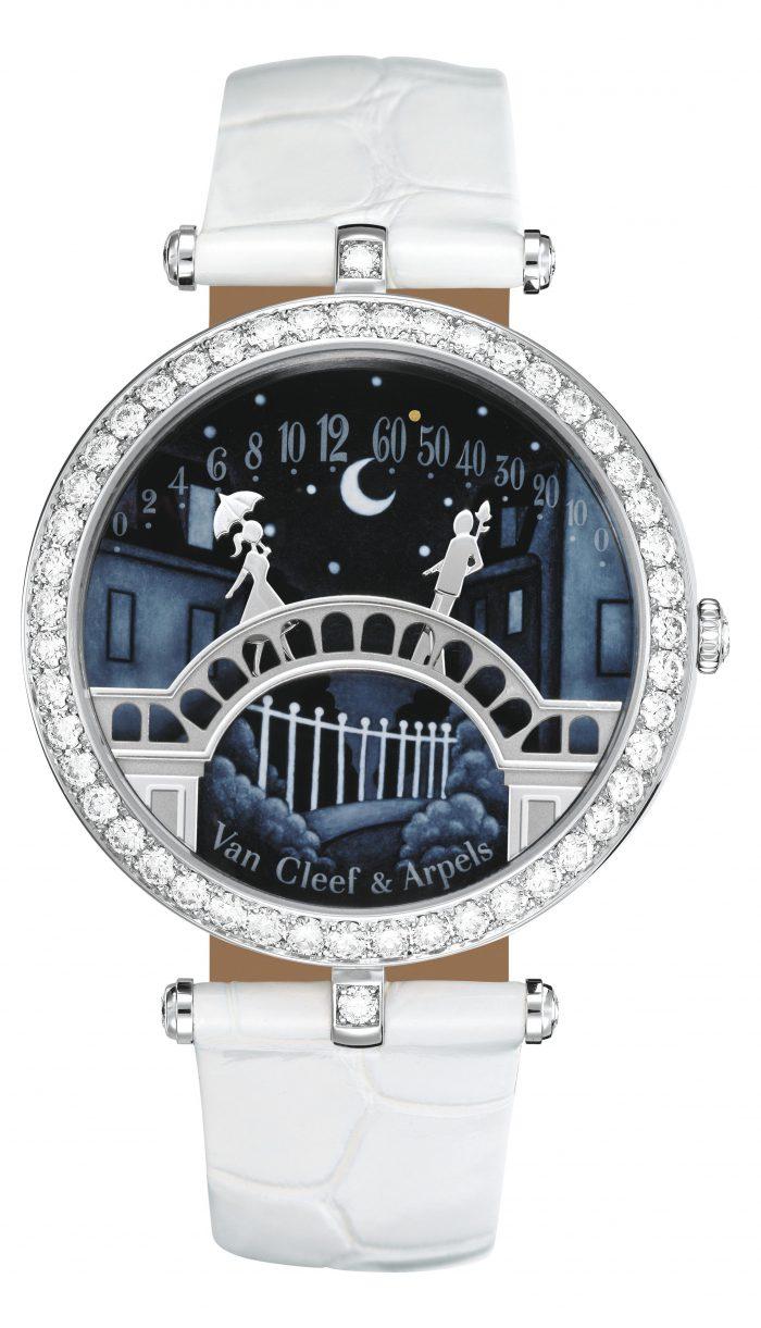 "Lady Arpels Pont des amoureux - VCARN9VI00 WG case, bezel with round diamonds, ""contre jour"" enamelling, WG sculpted characters Retrograde mechanical movement"