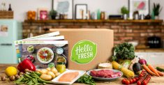 Hello Fresh box on table of fresh food and meat with recipes. Home delivery services