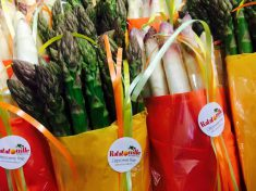 Asparagus in Ratatouille.ch packaging with link to website. Home delivery services