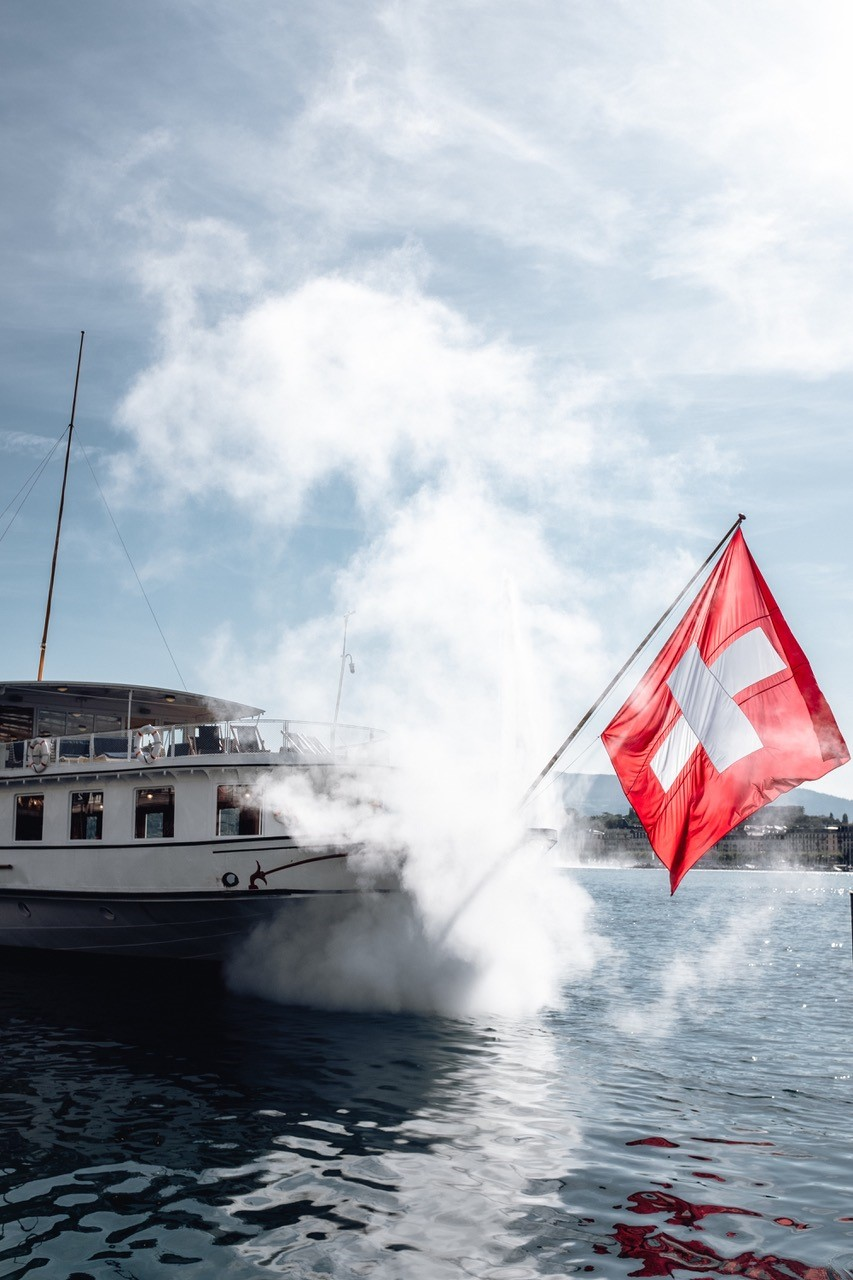 Boat on the Lac Leman with flying flag reorganisation des douanes
